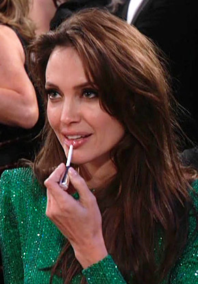 Angelina Jolie applying Chantecaille lip gloss in Love at the Golden Globes