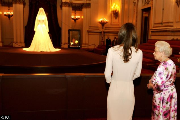 Kate Middleton and the Queen view the wedding dress